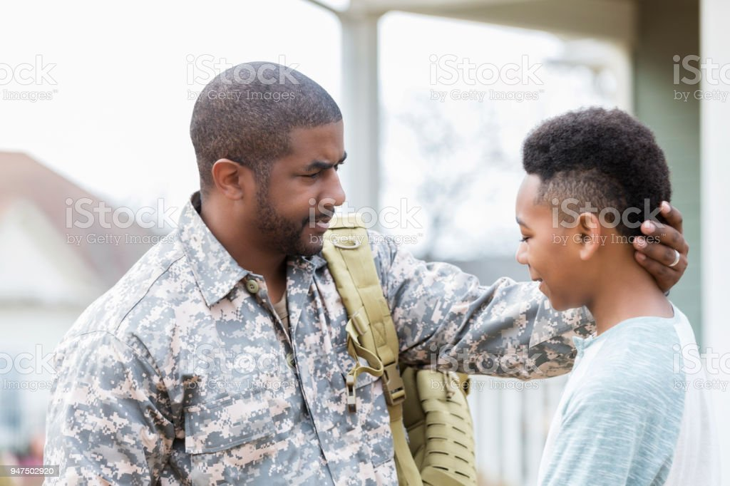 Military dad gives son advice stock photo