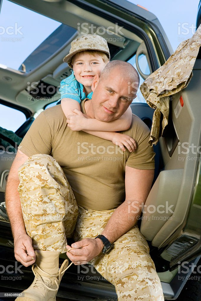 Military Dad Preparing to Ship Out stock photo