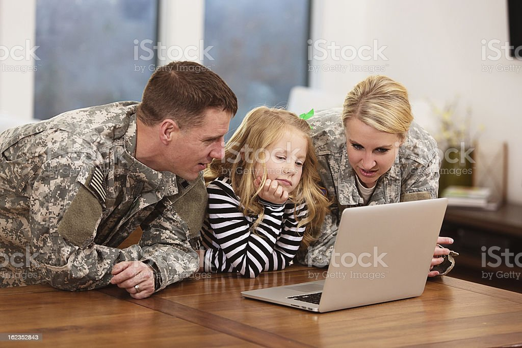Military family looking at a laptop stock photo