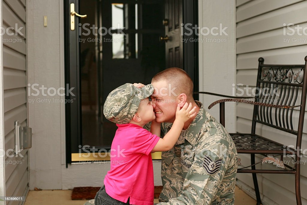 Military father and son having a cute moment on the porch stock photo