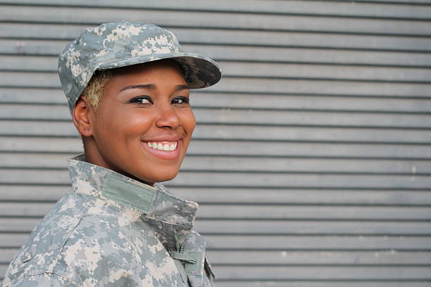 Military female smiling with copy space Military female smiling with copy space. military lifestyle stock pictures, royalty-free photos & images