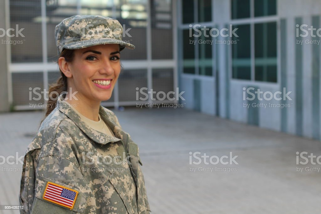 Military female smiling with copy space stock photo