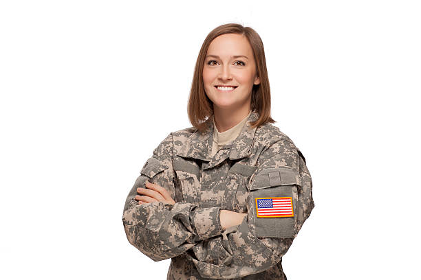 Military female with her arms crossed A smiling soldier in camouflage clothing air force stock pictures, royalty-free photos & images