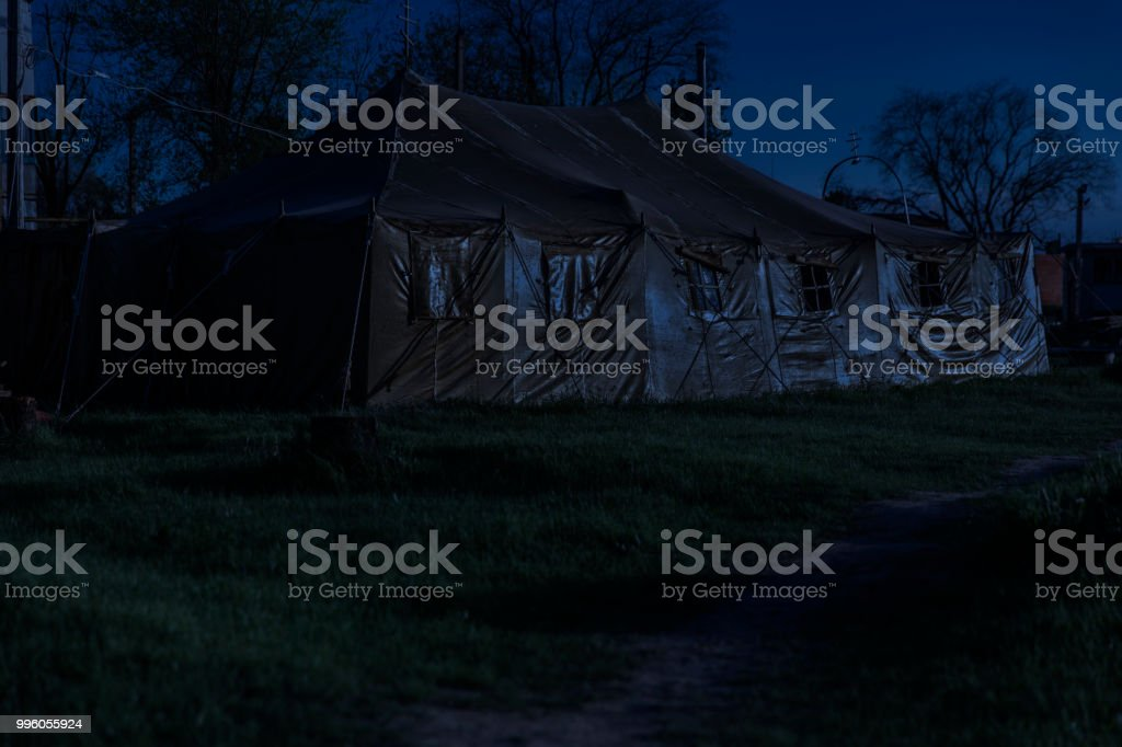 Military field chapel in the tent. Night shoot stock photo