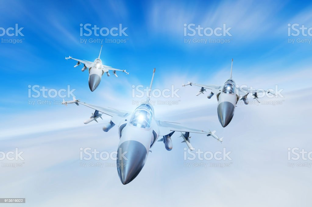 Military fighters jet three group aircraft at high speed, flying high in the sky. stock photo