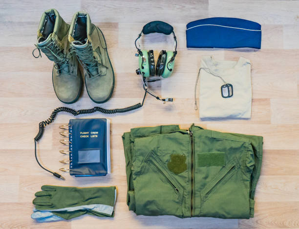 Military flying crew uniform flat lay Military flying airman uniform with headset flat lay background flight suit stock pictures, royalty-free photos & images