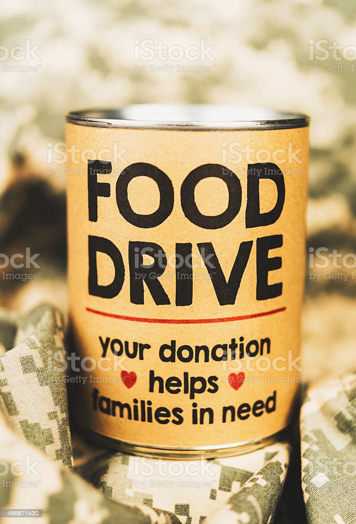 Military food drive on camouflage uniform fabric stock photo