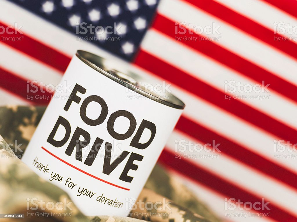 Military food drive on camouflage uniform fabric with US flag stock photo