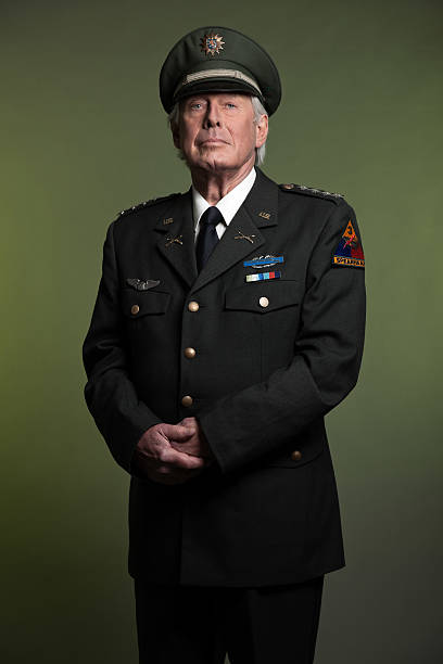 Military general standing proud in uniform Military general in uniform. Studio portrait. major military rank stock pictures, royalty-free photos & images