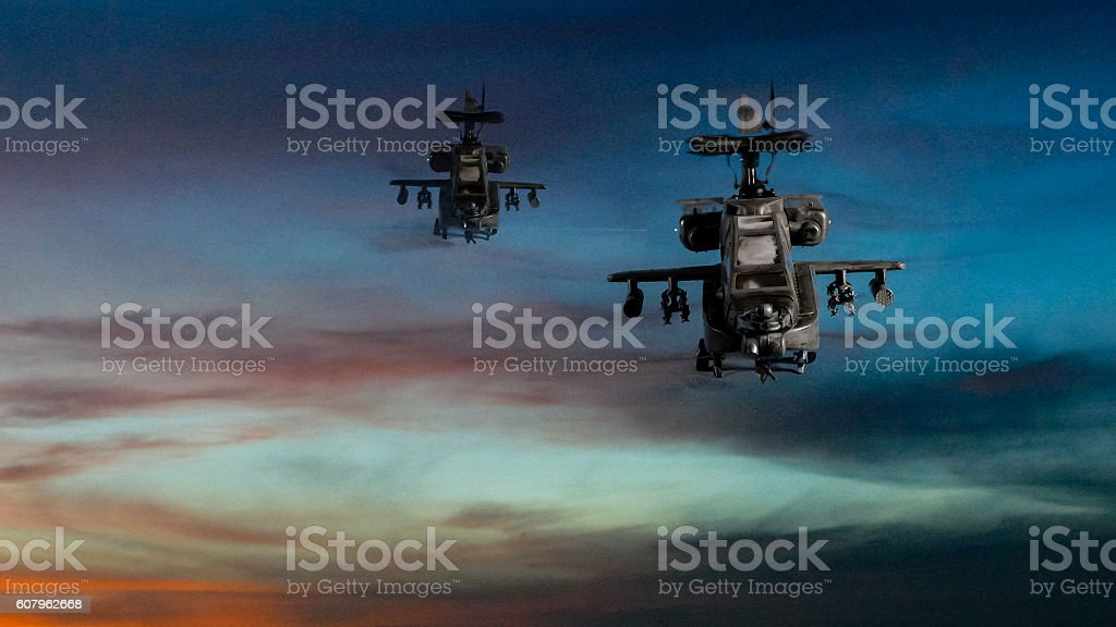 Military gunships flying with dramatic sky stock photo