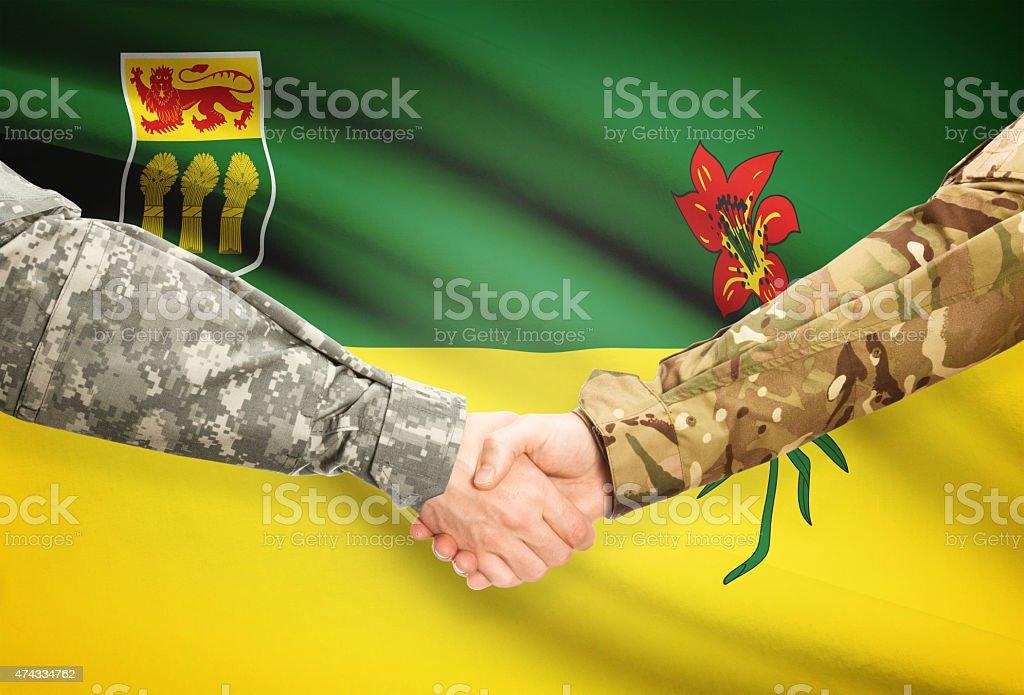 Military handshake and Canadian province flag - Saskatchewan stock photo