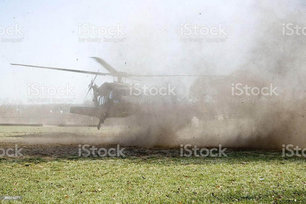 Military Helecopter Landing with Debris royalty-free stock photo