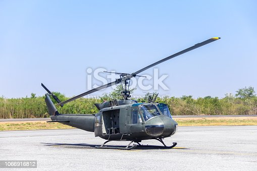 istock Military helicopter (huey) at a base 1066916812