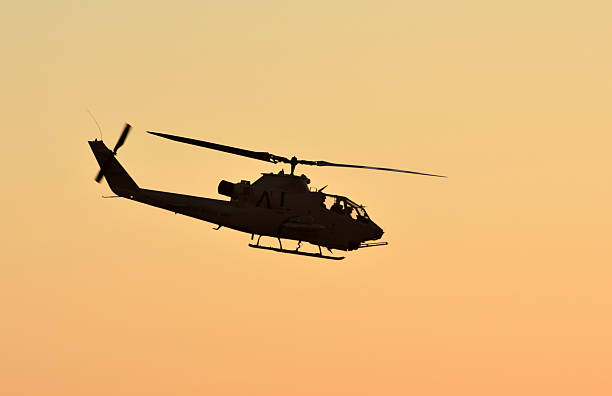 Military helicopter at sunset stock photo