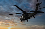 Military Helicopter flaying at sunset