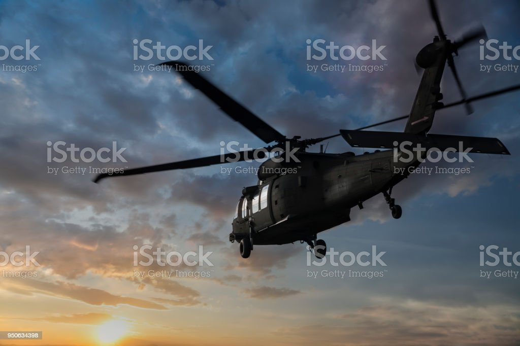 Military Helicopter flaying at sunset stock photo
