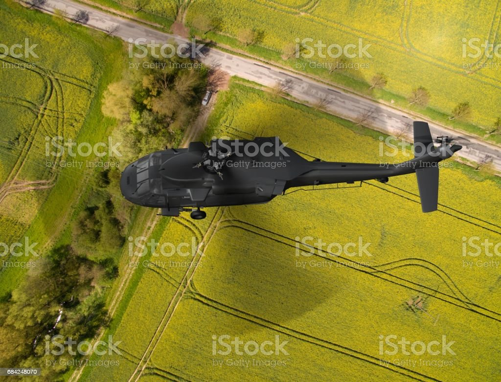 military Helicopter in flight - aerial view close up royalty-free stock photo
