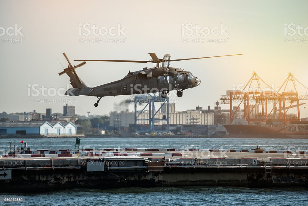Military helicopter landing on heliport in New York City. stock photo