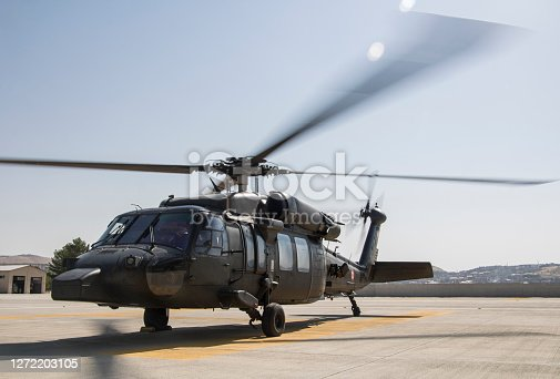 military helicopter on heliport
