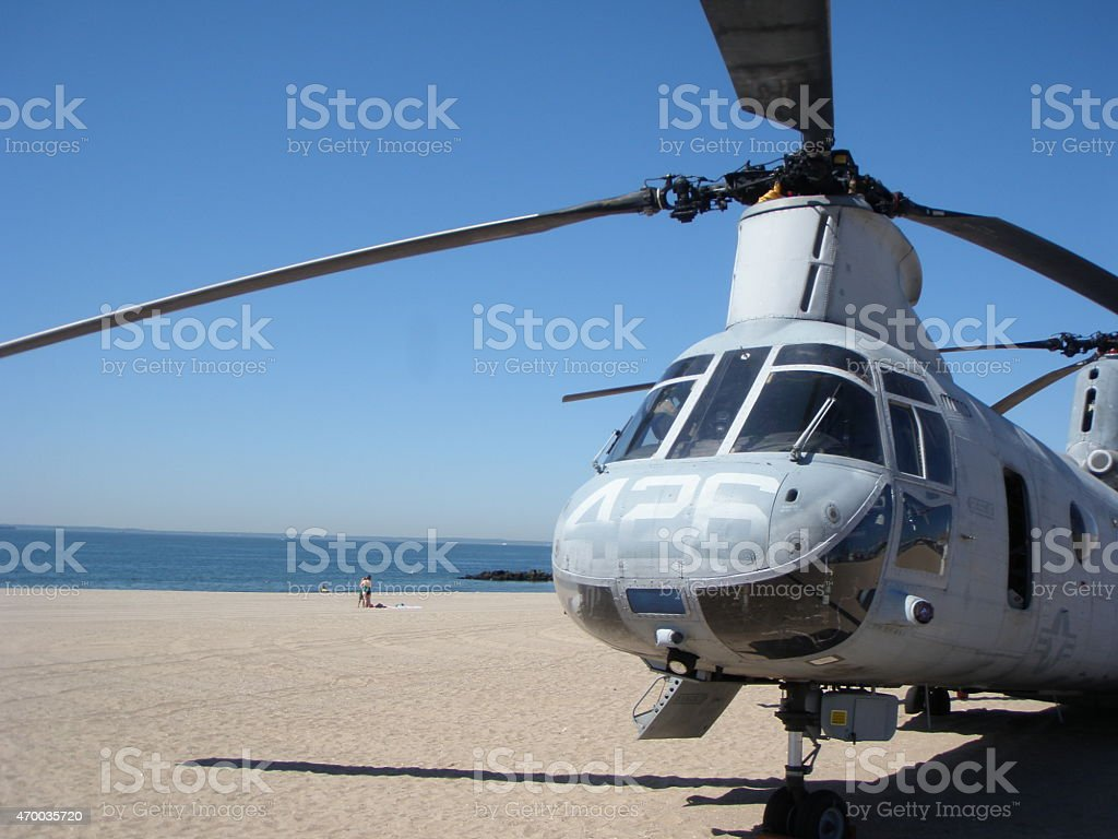 Military helicopter on the beach stock photo