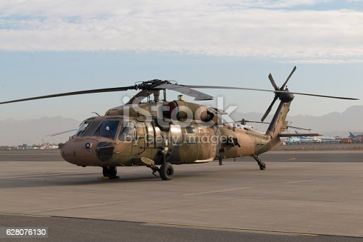 Military helicopter landed on a military base