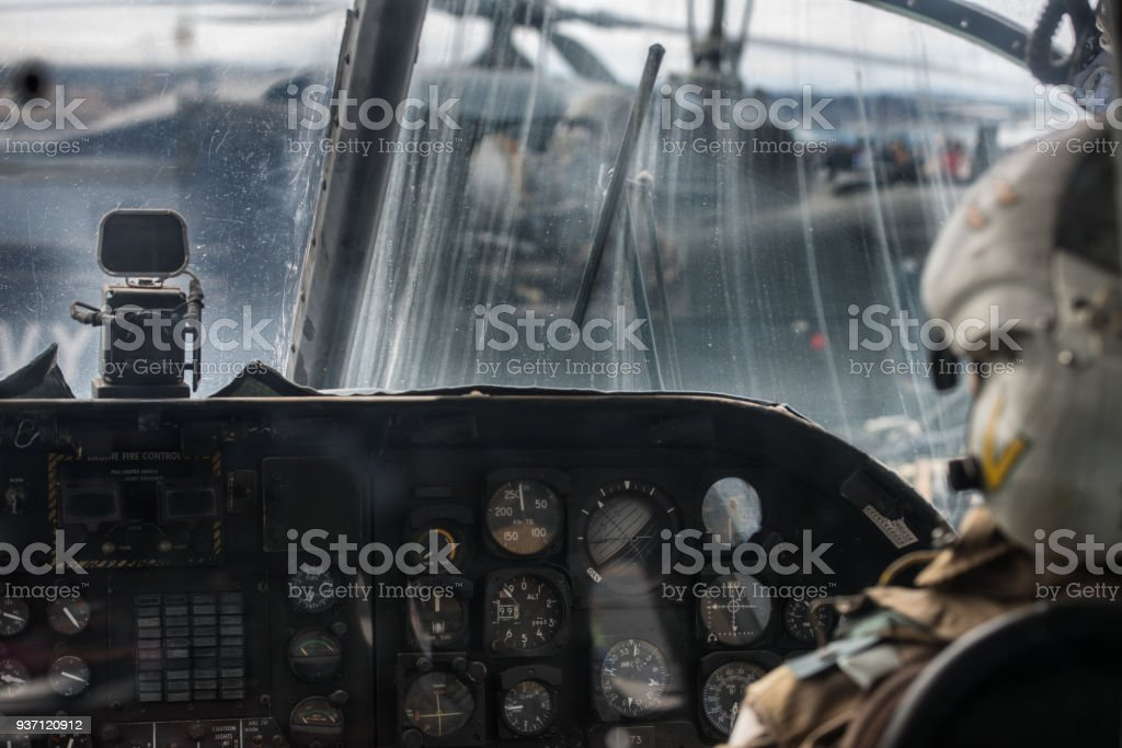 Military helicopter pilot operate in navy aircraft cabin at army base stock photo