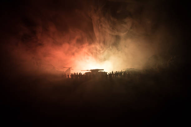 Military helicopter ready to fly from conflict zone or Silhouettes of a large crowd of people trying to escape with helicopter. Decorated night installed photo stock photo