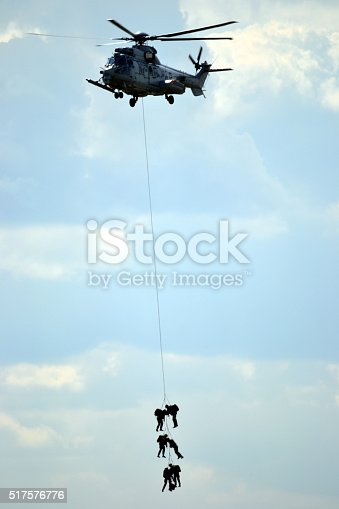 istock Military helicopter with soldiers 517576776