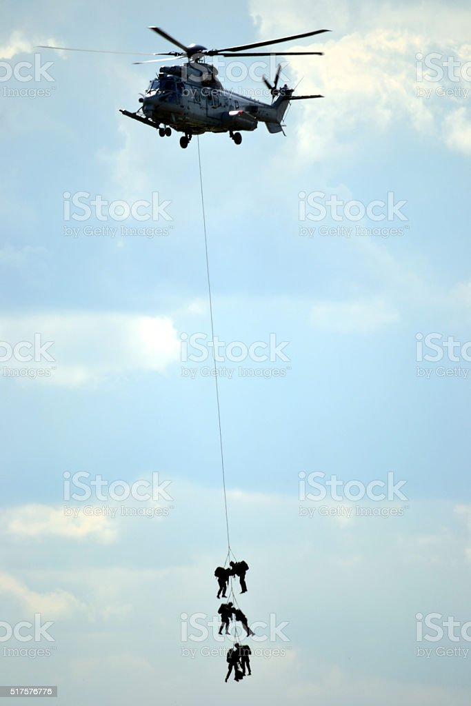 Military helicopter with soldiers stock photo