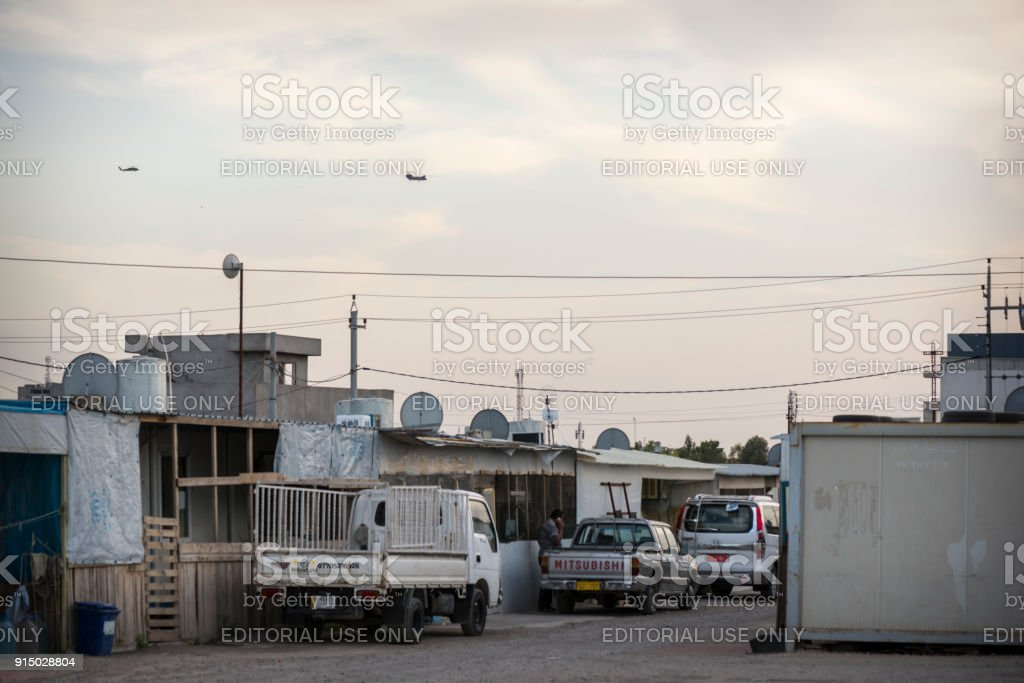 Military helicopters above IDP camp in Erbil, Iraq stock photo