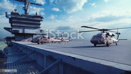 Military helicopters Blackhawk take off from an aircraft carrier at clear day in the endless blue sea.