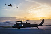 Military helicopters on Airbase at sunset