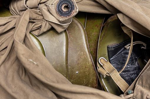 Soviet steel helmets in a canvas army bag. Russian infantry helmet