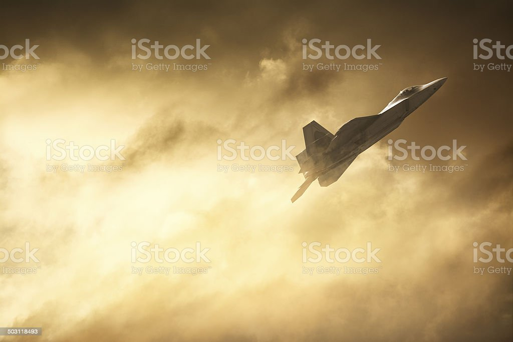 F22 Military Jet Against Dramatic Sky stock photo