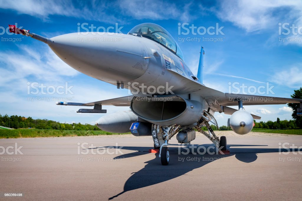 Military jet aircraft F-16 Military jet aircraft F-16 in military airport in Poznan, Poland Aerospace Industry Stock Photo