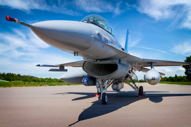 Military jet aircraft F-16 Military jet aircraft F-16 in military airport in Poznan, Poland air force stock pictures, royalty-free photos & images