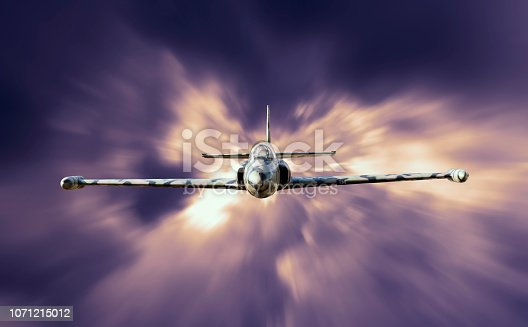 istock Military jet fighter airplane flying above the clouds 1071215012