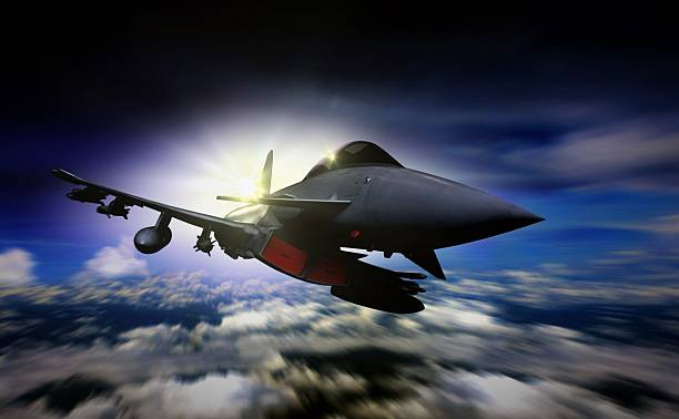 Military jet flying during sunrise with blur motion background Military jet flying during sunrise with blur motion background supersonic airplane stock pictures, royalty-free photos & images