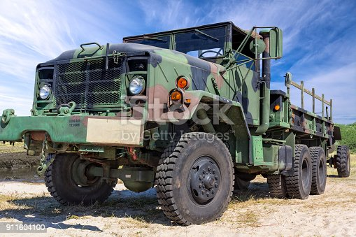 istock US Military M-923 A1 truck with cannon on military training ground 911604100