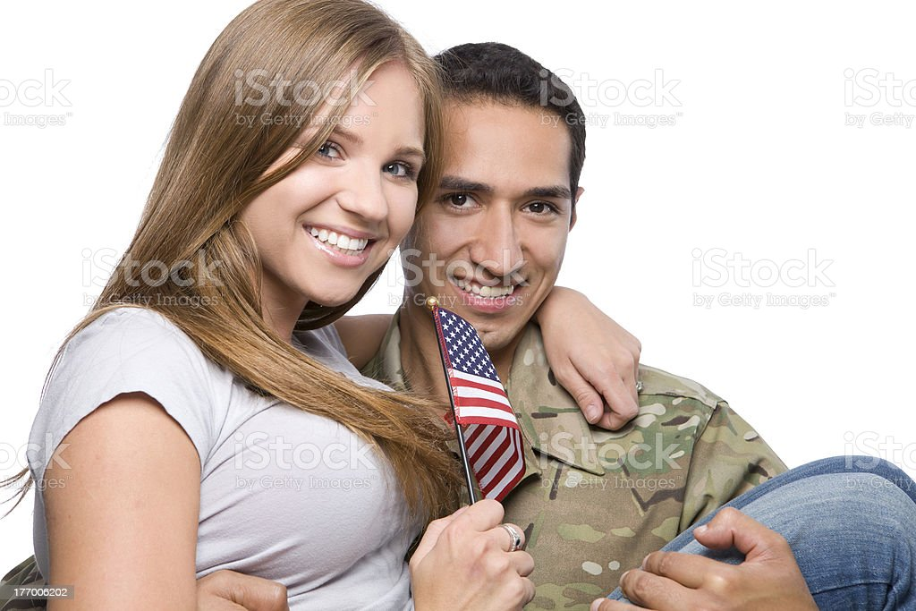 Military Man has Happy Wife in His Arms stock photo