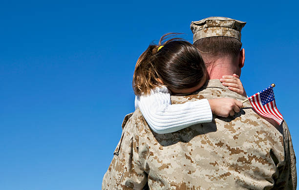 military man hugs daughter - armed forces stock photos and pictures