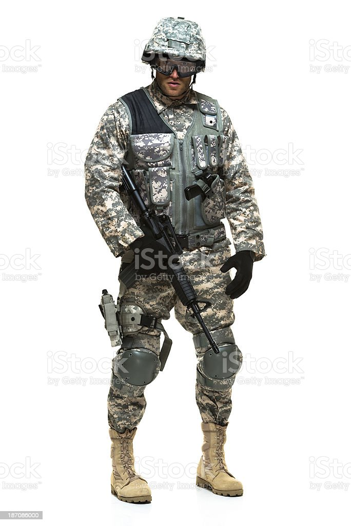 Military man standing with rifle royalty-free stock photo