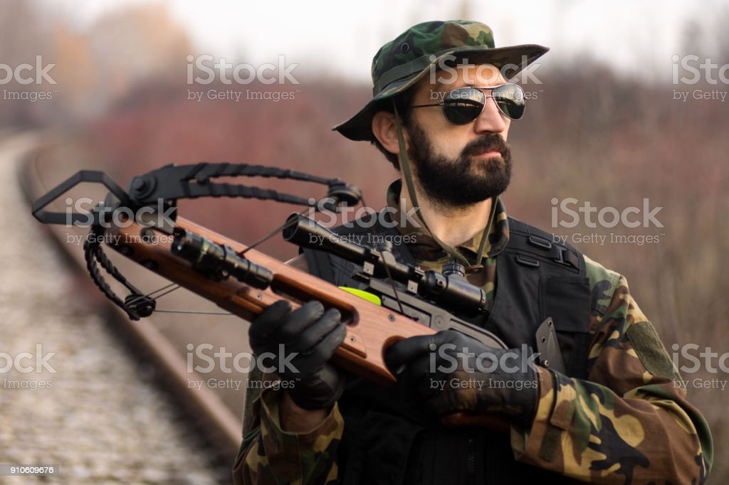military man with crossbow stock photo