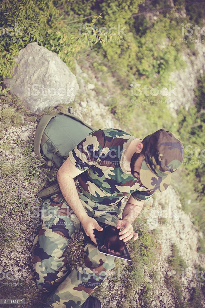 Military man with tablet stock photo