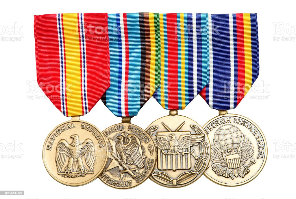 4 Military medals hanging on colorful ribbons stock photo