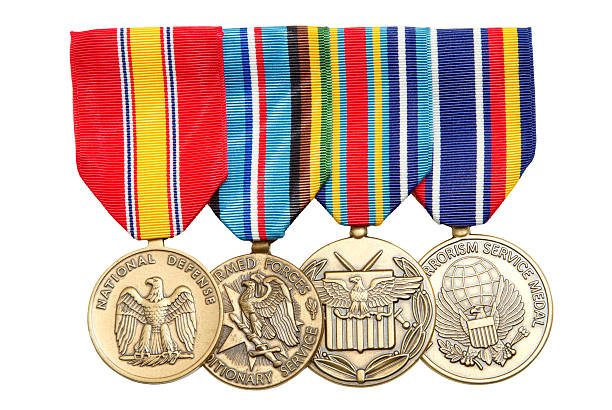 4 military medals hanging on colorful ribbons - medal stock photos and pictures
