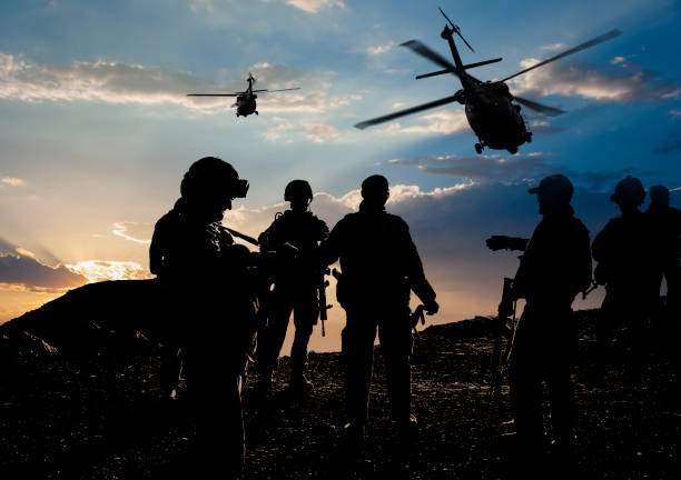 military mission at dusk - armed forces stock photos and pictures