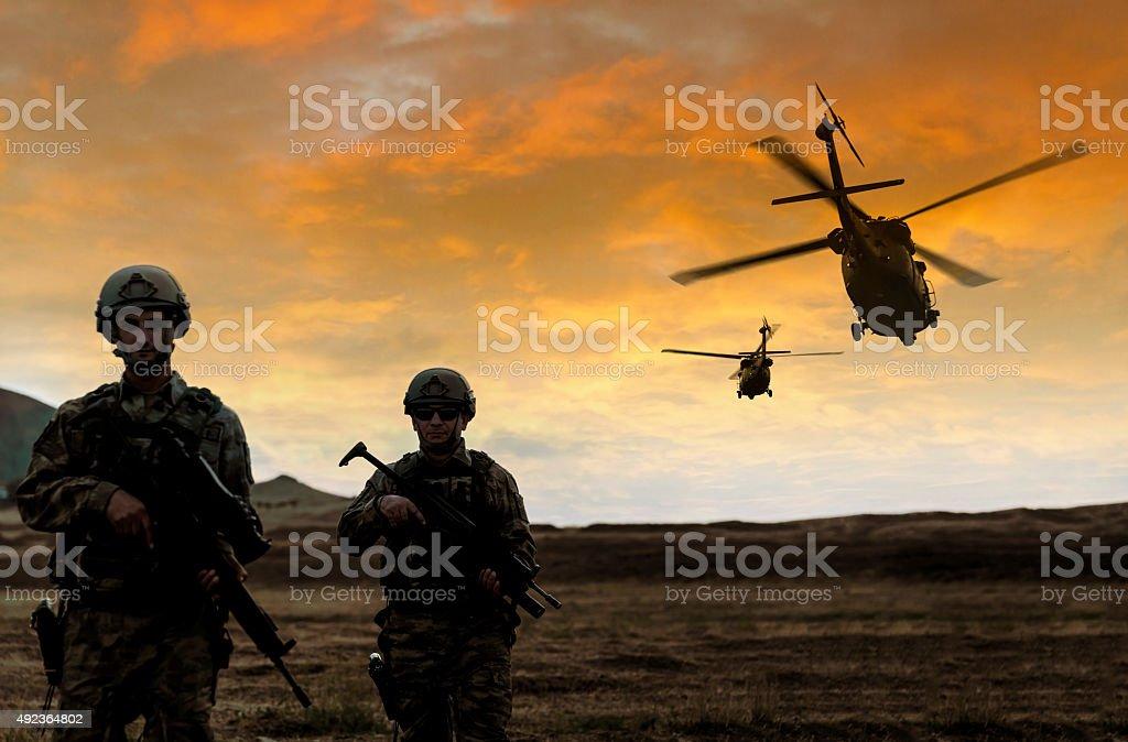 Военная миссия на закате стоковое фото