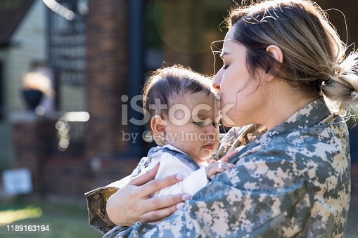 The military mother hugs her baby daughter before being deployed overseas.