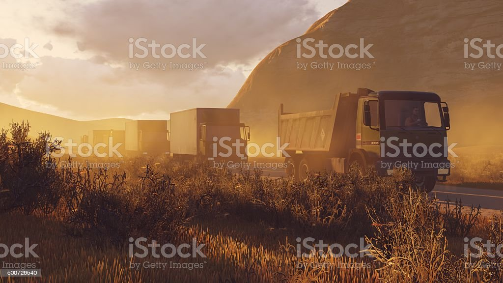 Military motorcade on a desert road at evening time stock photo